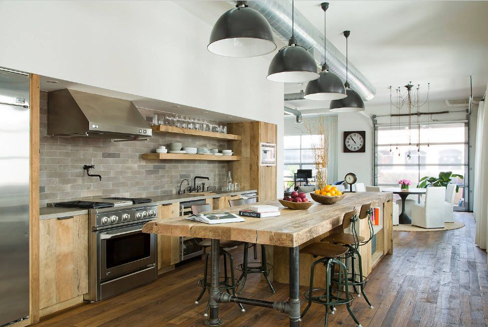 Gray lampshades and raw wooden material for the loft styled kitchen