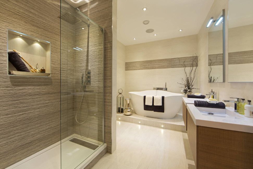 Nice calming gray color theme for the Modern styled bathroom with glancing tiled floor and streaked tile for the shower cabin