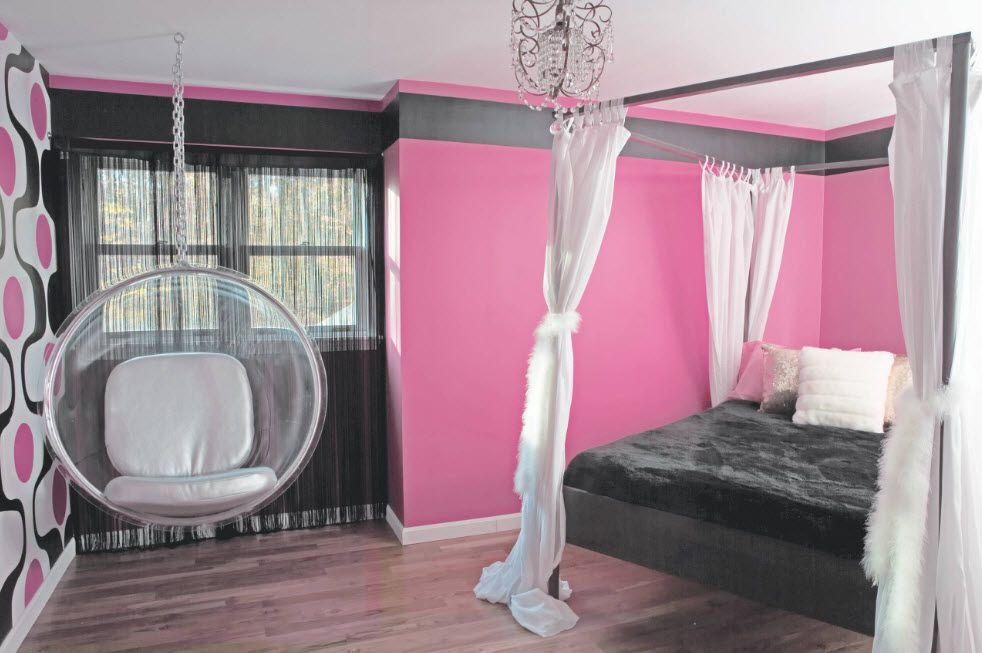 Pink painted walls and the plastic silver hanging armchair