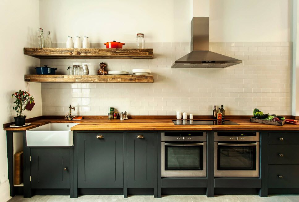 Steel extractor hood for the minimalistic loft kitchen interior