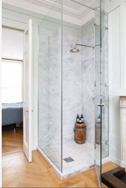 Modern Bathroom Interior Shower Cabin Design. Natural marble stone with dark streaks for walls