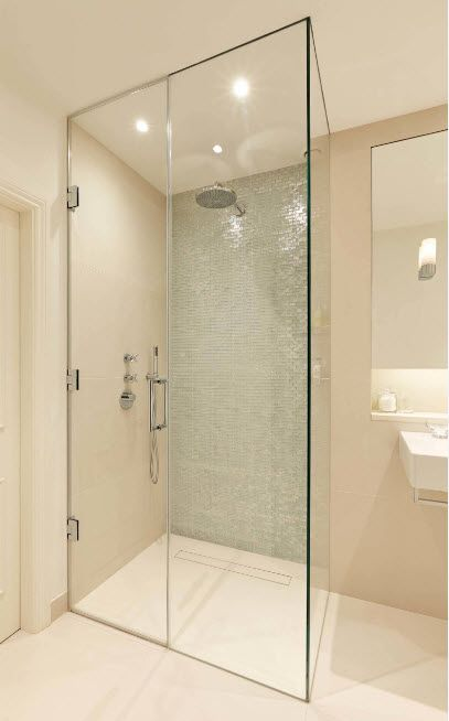Modern Bathroom Interior Shower Cabin Design. Pastel creamy atmosphere and plain glass construction
