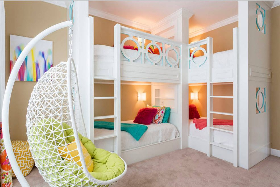 White matted bunk bed and the plastic wicker imitating sispended chair