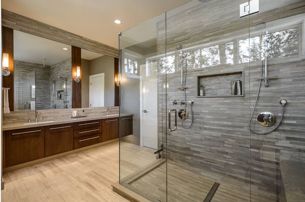 Spectacular airy design of the bathroom shower cabin with gray marable trimming