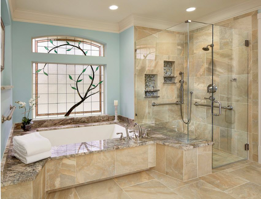 Full-fledged bathroom with bathtub and glass separated wall-high cabin