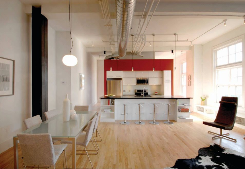 Light wooden floor laminate and matted white wall paint with red frame at the kitchen zone