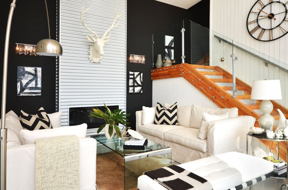 Gypsum antlers and the textured gray wall with the artificial fireplace