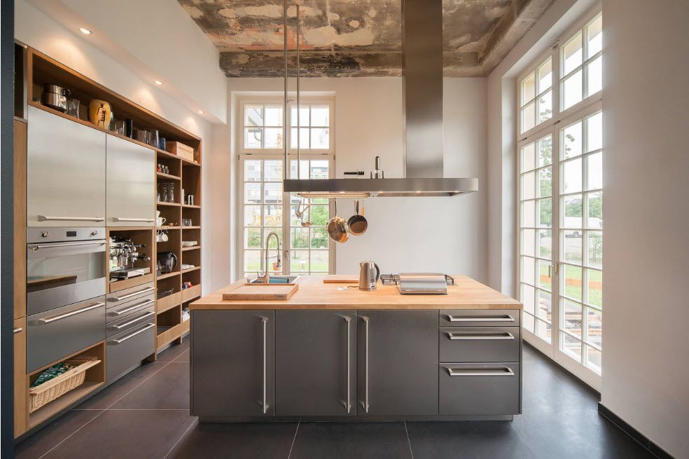 Wood and steel combination for successful loft kitchen interior