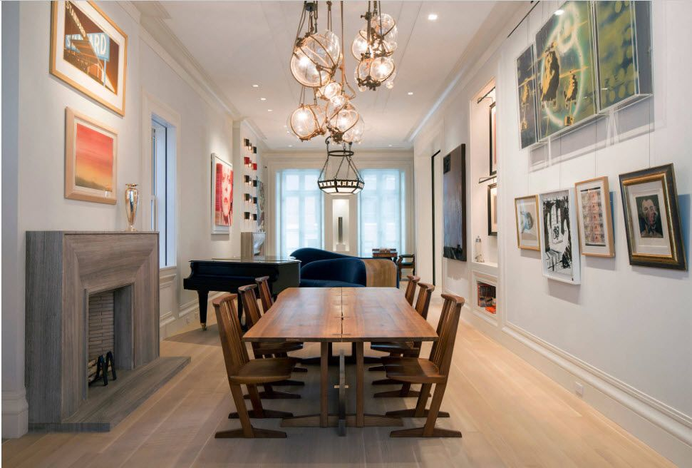 Strict classic dining room interior with pictures and fireplace