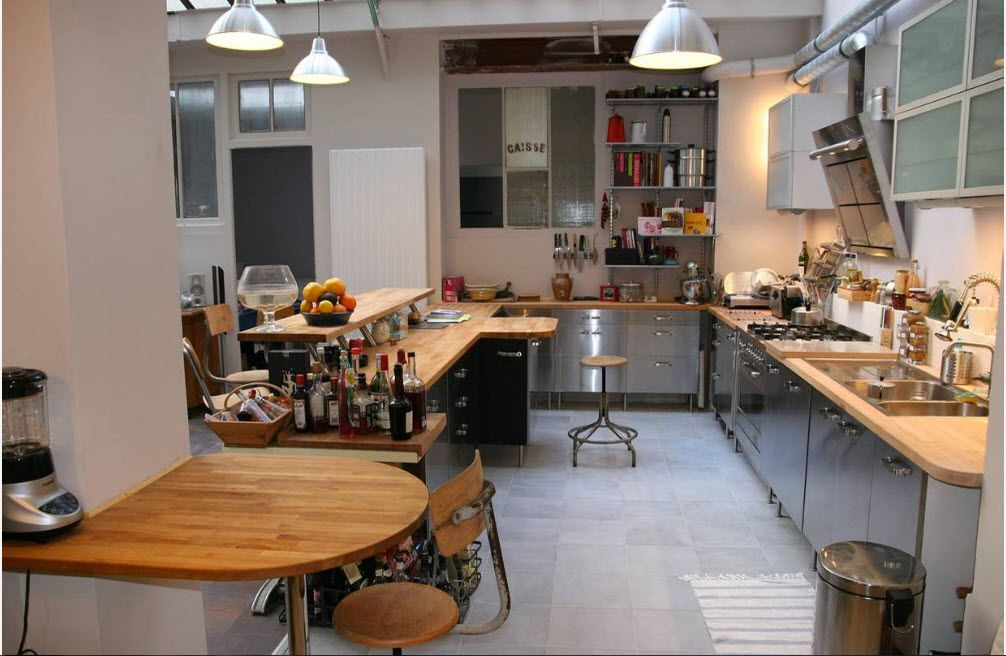 Wood, steel and hanging lamps in gray stylistic with concrete floor