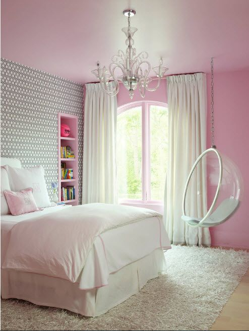 GIrl's room with pink walls and white framed suspended chair