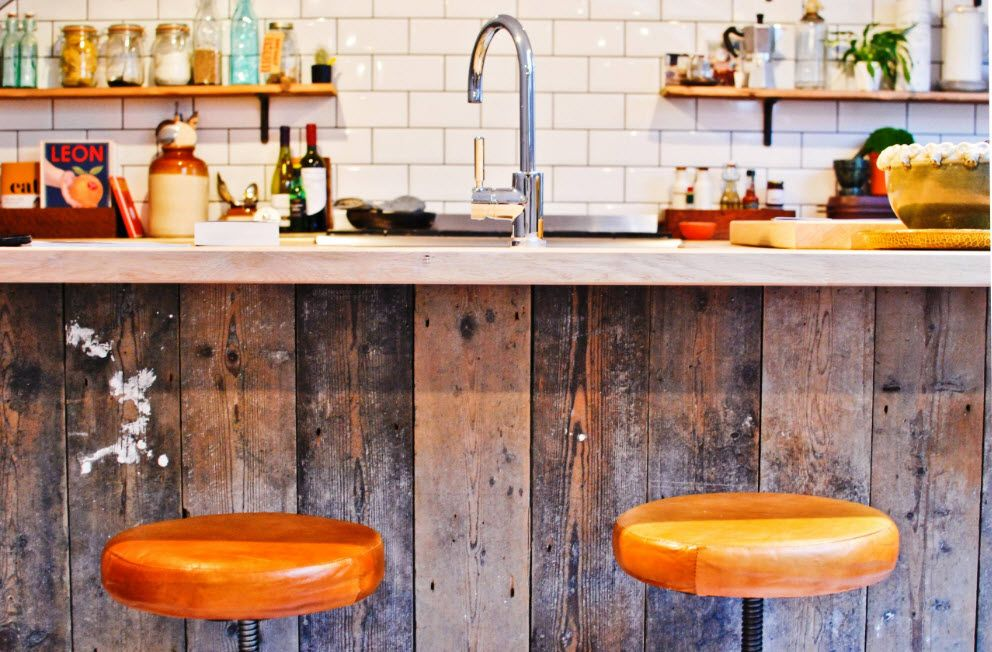 Nice wooden kitchen island siding and the bent tap reminiscent of the Rustic style