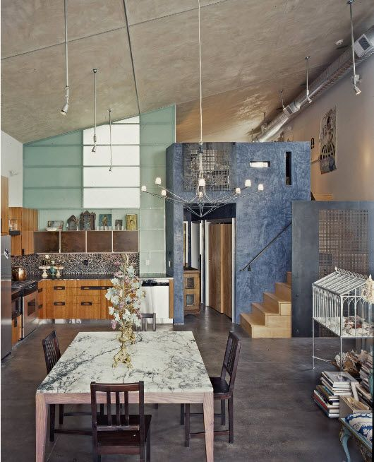 Loft Styled Kitchen. Industrial Motiffs for Comfortable Life. Slanted ceiling, marble decorated table at the light and colorful interior