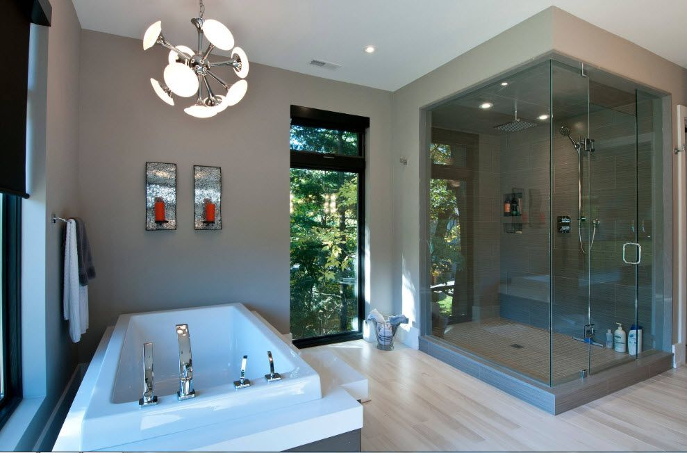 Open layour of the large bathroom with mixing of styled and big glas cabin