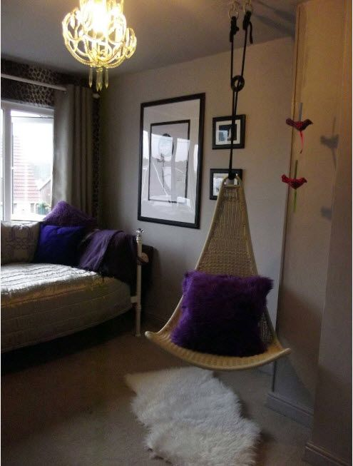 Unusual form of suspended chair with pruple fluffy cushion