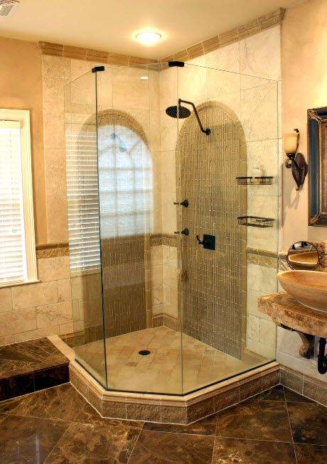 Peach tone of the marble wall finishing and black plumbing in the shower cabin