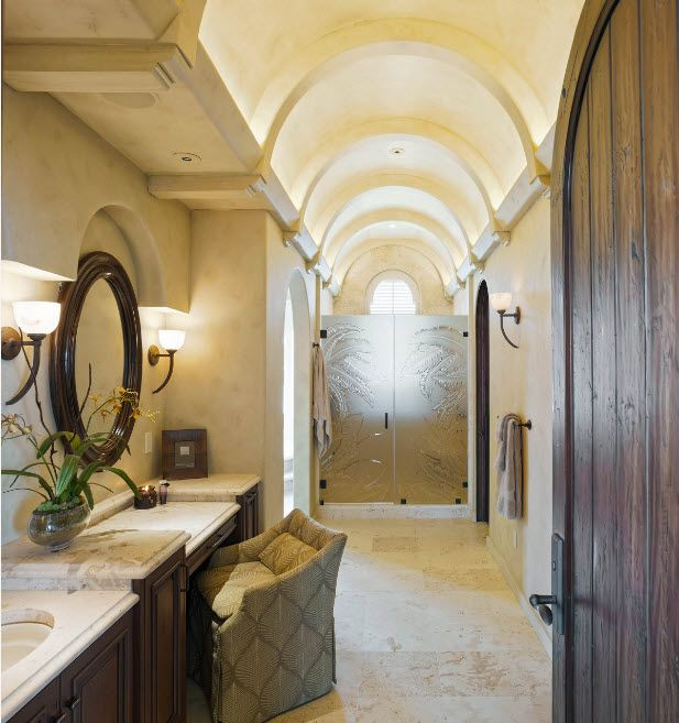 Arched hall of the royal sized bathroom with glass partition