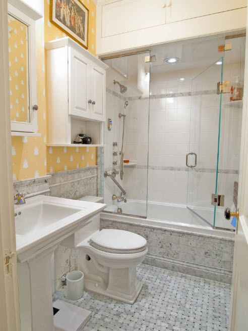 Shallow mosaic in the bathroom with yellow trimmed walls and separate shower zone