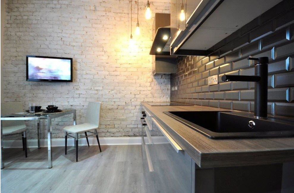Loft Styled Kitchen. Industrial Motiffs for Comfortable Life. Black splashback tile and white texture at the walls