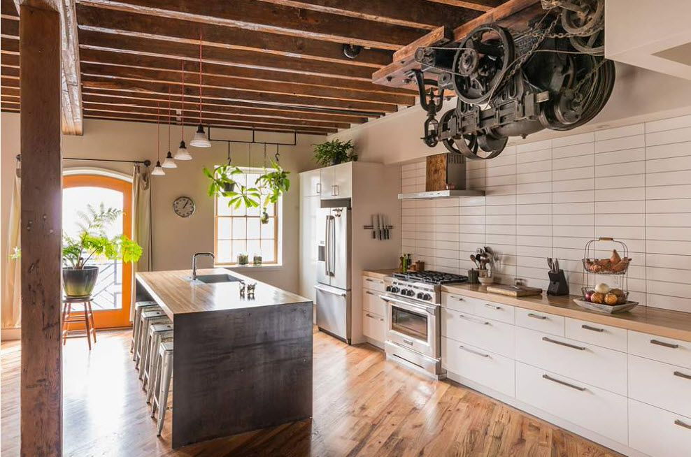 Loft Styled Kitchen. Industrial Motiffs for Comfortable Life. Mix of styles and huge space with open ceilnig beams