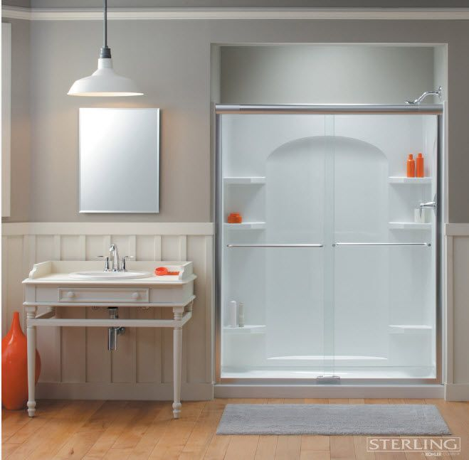 Modern Bathroom Interior Shower Cabin Design. Wood and plastic in the modern styled space with orange accents