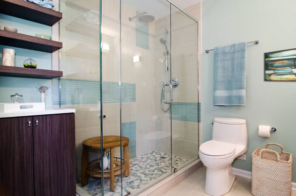 Blue Marine style notes in the casual styled bathroom with large shower cabin with wooden chair inside