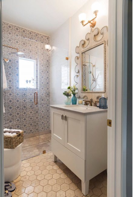 Prominent Classic style with blue notes in the wall finishing and peculiarly bordered mirror