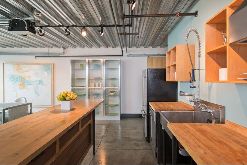 Loft Styled Kitchen. Industrial Motiffs for Comfortable Life. Light wooden furniture and the Aluminum profiles for the ceiling