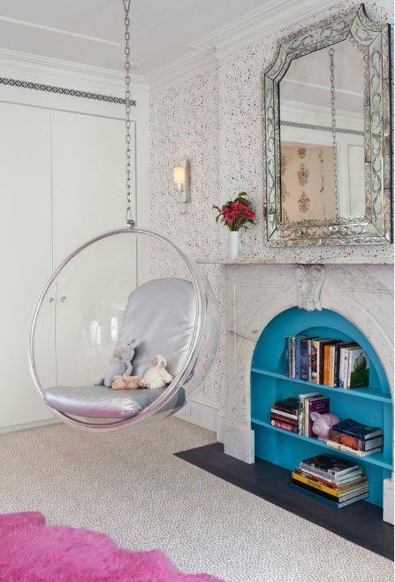 Hanging plastic armchair in the garish designed room
