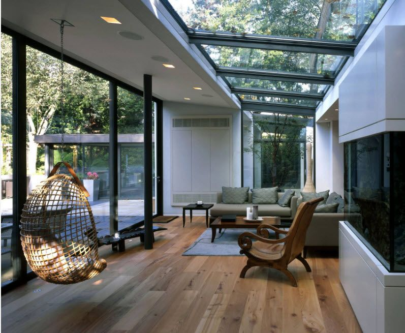 Suspended Bubble Chair. Modern Interior Ideas. Glass roof and cage carcass of the hangin chair in the ultramodern house