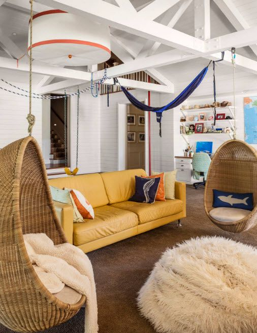 Suspended Bubble Chair. Modern Interior Ideas. Brown sofa and wicker chairs