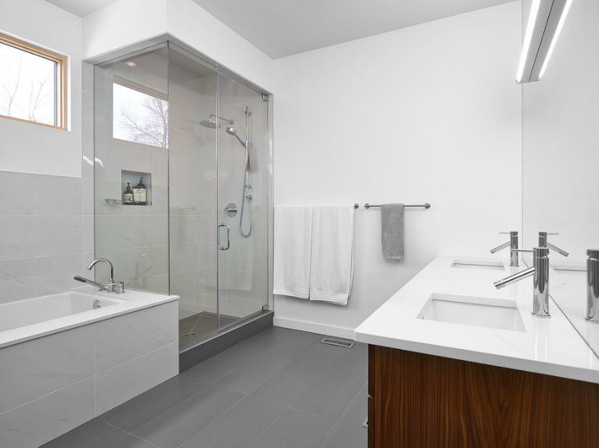 Modern Bathroom Interior Shower Cabin Design. White large space with bathtub and hovering vanity
