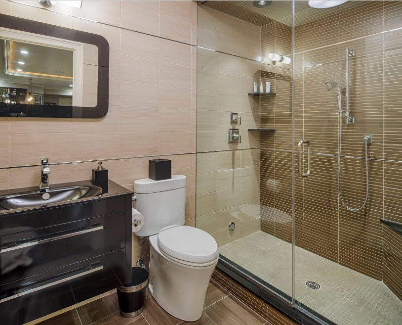 Modern Bathroom Interior Shower Cabin Design. Accentual glass and tile shower zone