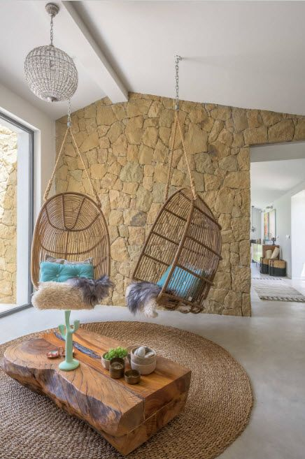 Suspended Bubble Chair. Modern Interior Ideas. Stone tiled walls