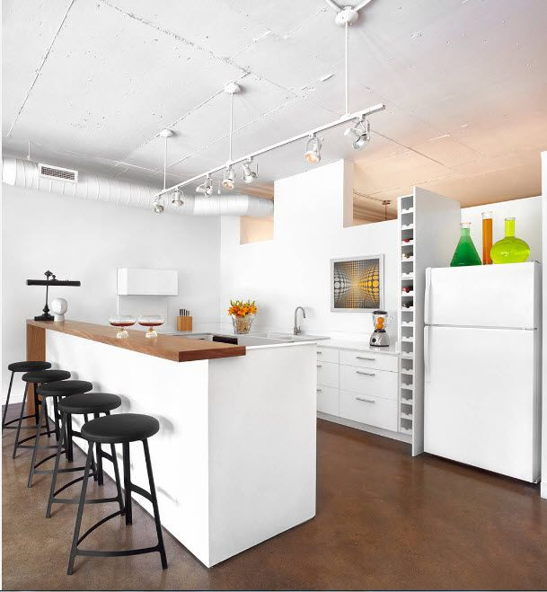 Loft Styled Kitchen. Industrial Motiffs for Comfortable Life. High black metal bar stools and the specklessly white long island