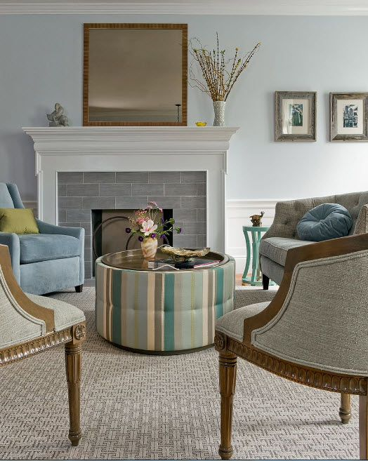Artificial Fireplace as Part of Comfortable Life. White neat fireplace frame with cozy mantelshelf
