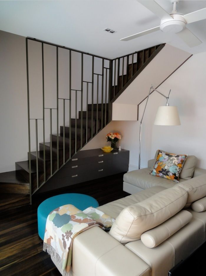 Modern private house interior with steel framed handrails at the staircase at the wall