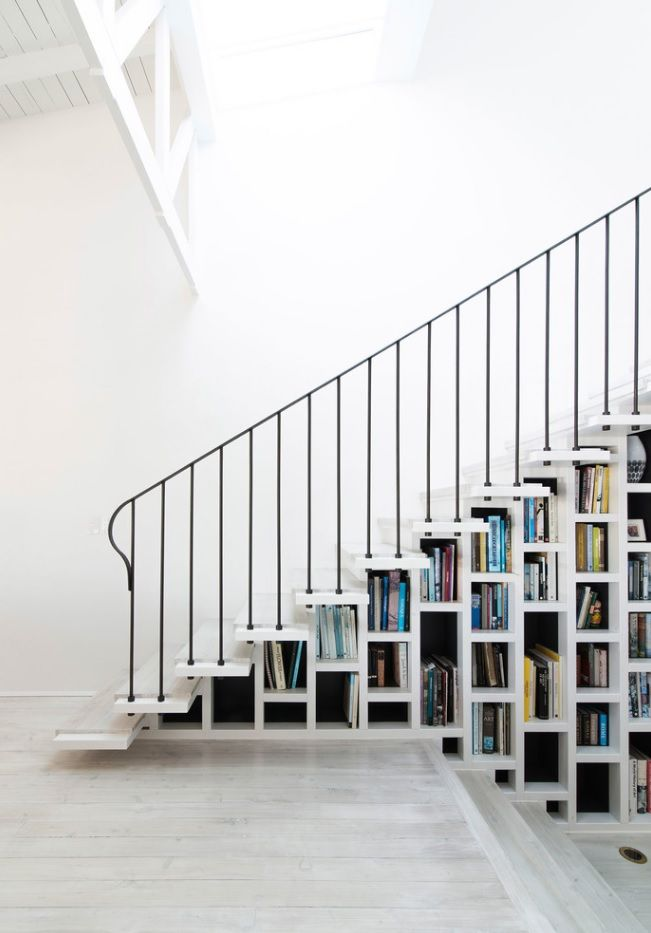 Absolutely white speckless interior for the modern airy stepped staircase with thin posts and matted handrail