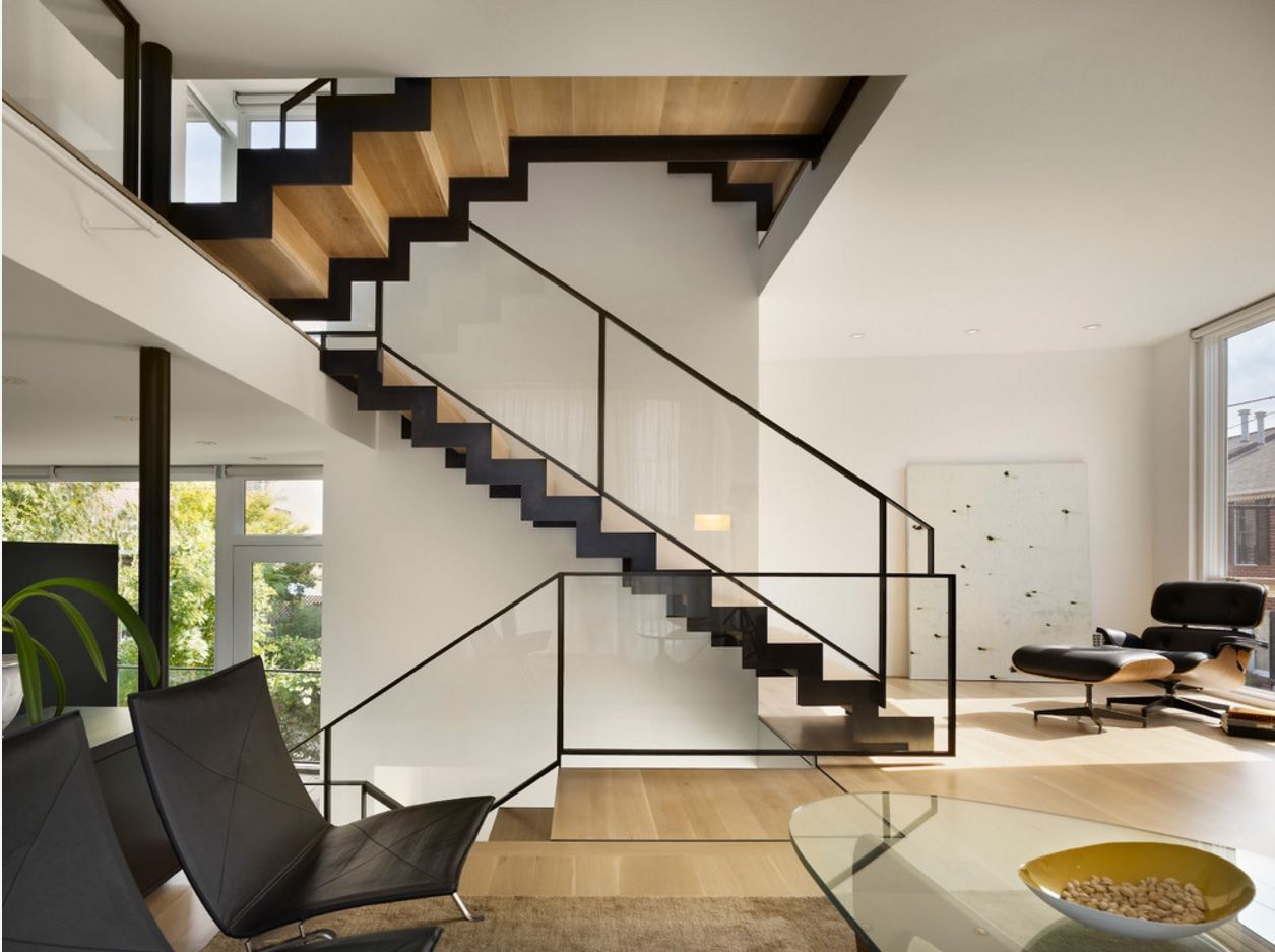 Modern Private House's Balustrade Design. Black sided wooden staircase with glass fencing and metal framed handrail