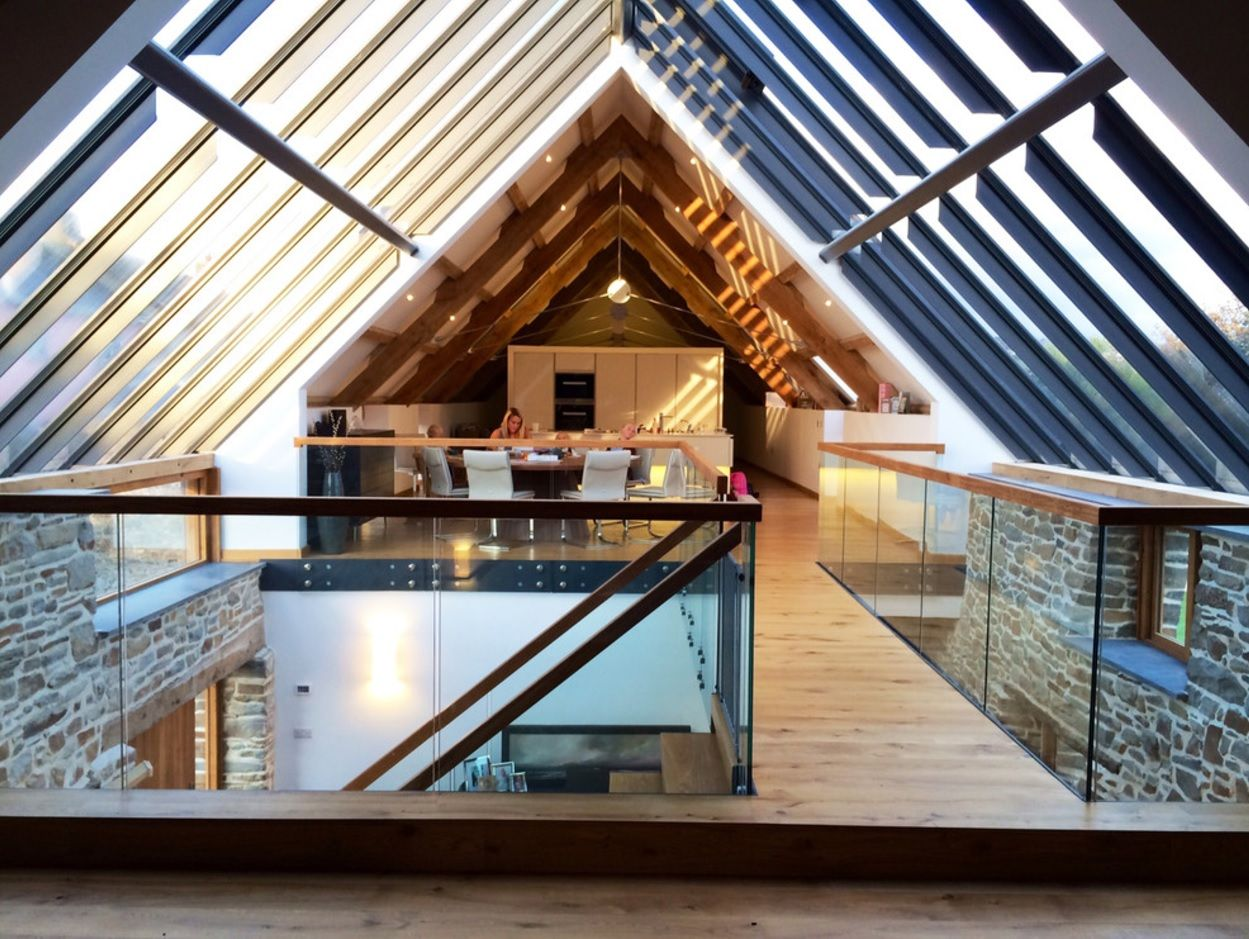 Modern Private House's Balustrade Design. Glass roof panels and the glass fencing of the modern styled staircase in the large loft