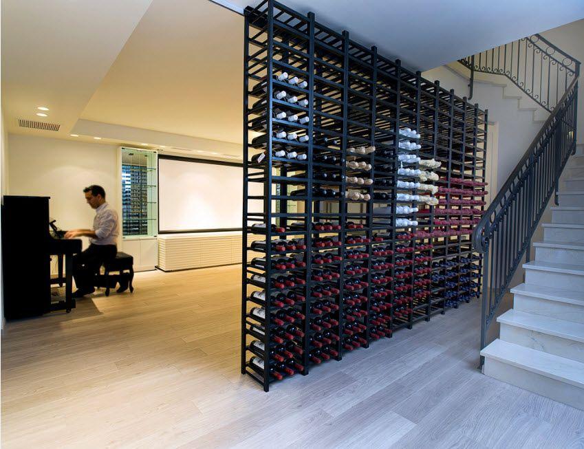 Black metal wine rack from floor to the ceiling