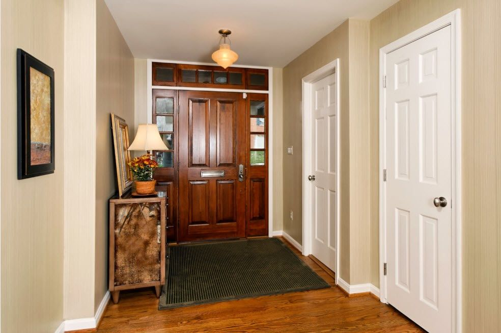 Interior Doors. Essential Element of Modern Apartment. Wooden instalation with lites and side panels