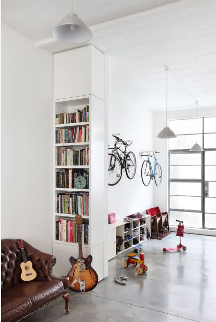 Small shelving for books and triffles in the modern studio apartment for active couple