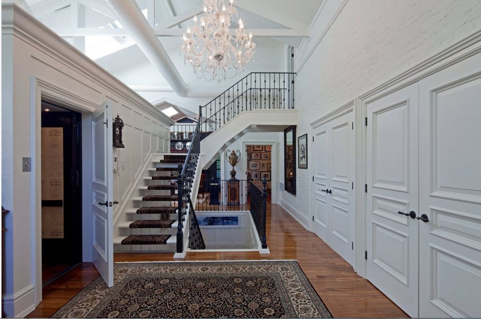Royal stairs of the private mansion with classic formed interior doors