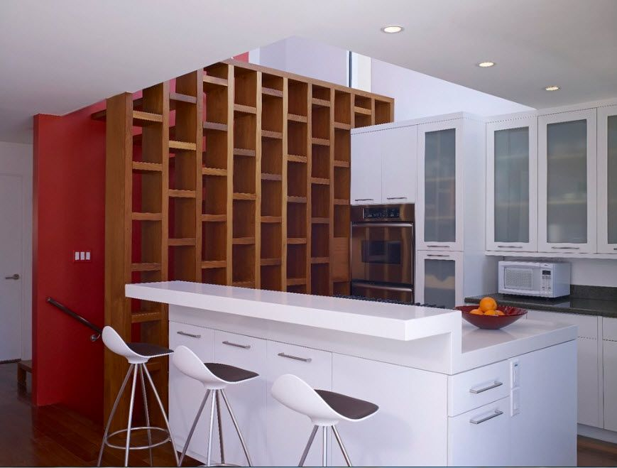 Wooden shelving with small frequent cells looks impressive in the modern white colored interior