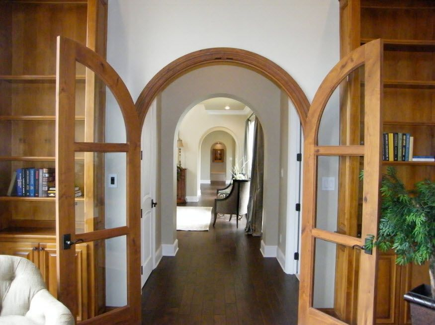 Unusual arch swinging doors of two pieces
