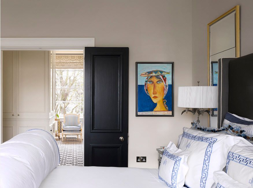 Black contrasting door for the modern white colored bedroom
