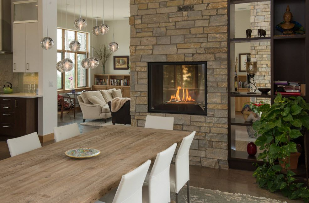 Decorative fireplace in the brickwork wall and the shelving for storing next to it