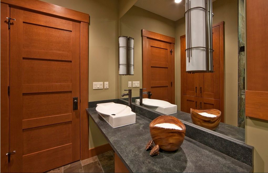 Bathroom with large mirror and nice solid door