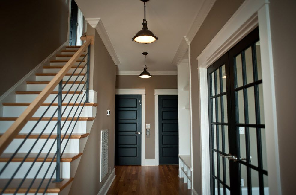 Interior Doors. Essential Element of Modern Apartment. Utilization of the under-stairs space